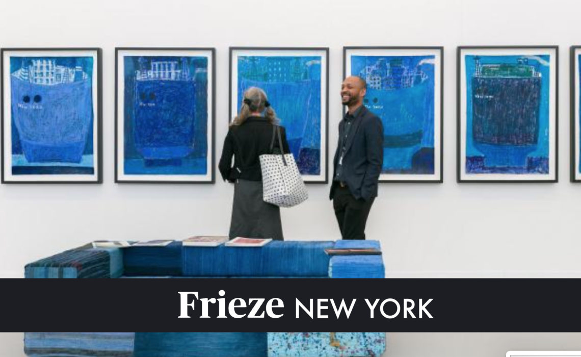 man and woman looking at blue paintings at frieze 2019 art fair