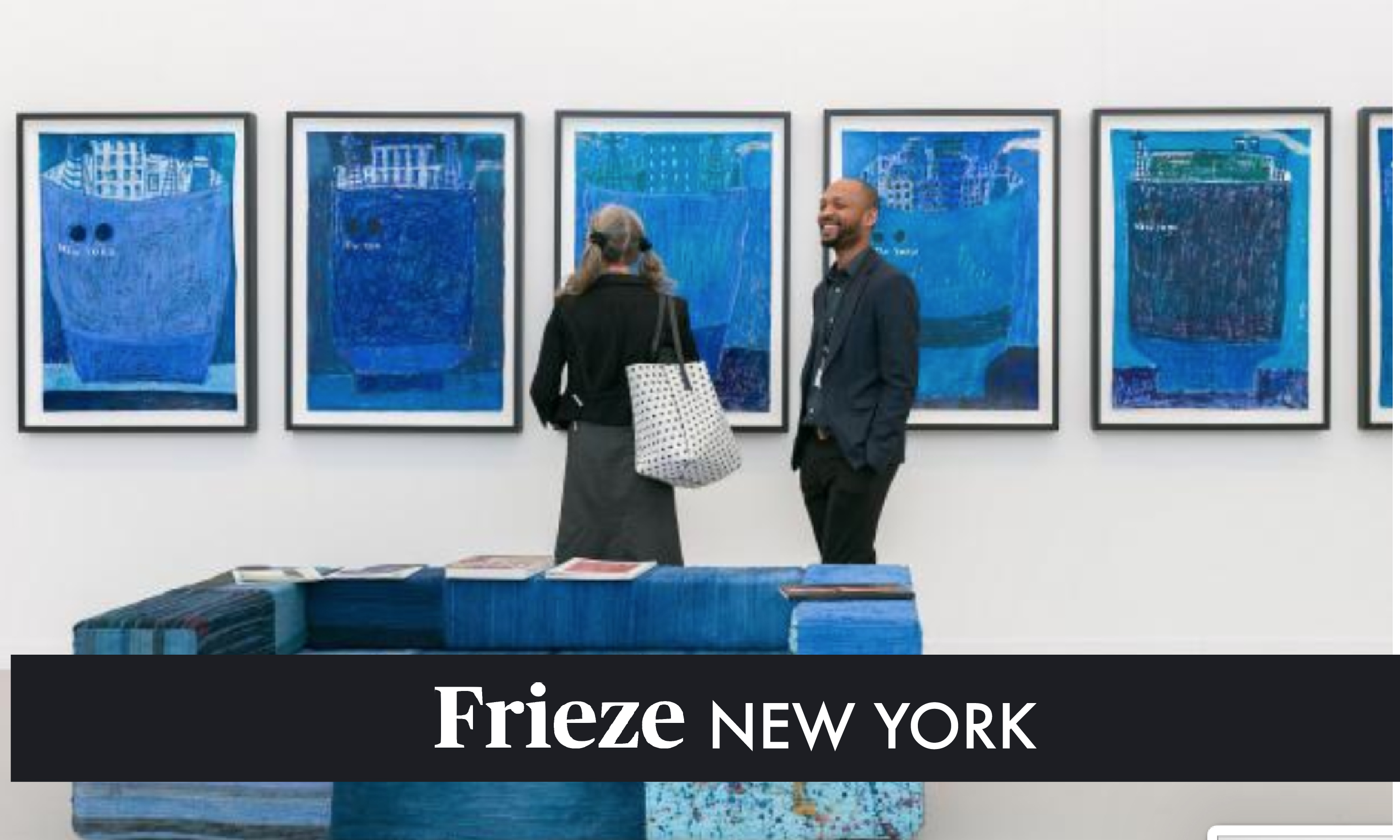 man and woman looking at blue paintings at frieze 2019 art fair