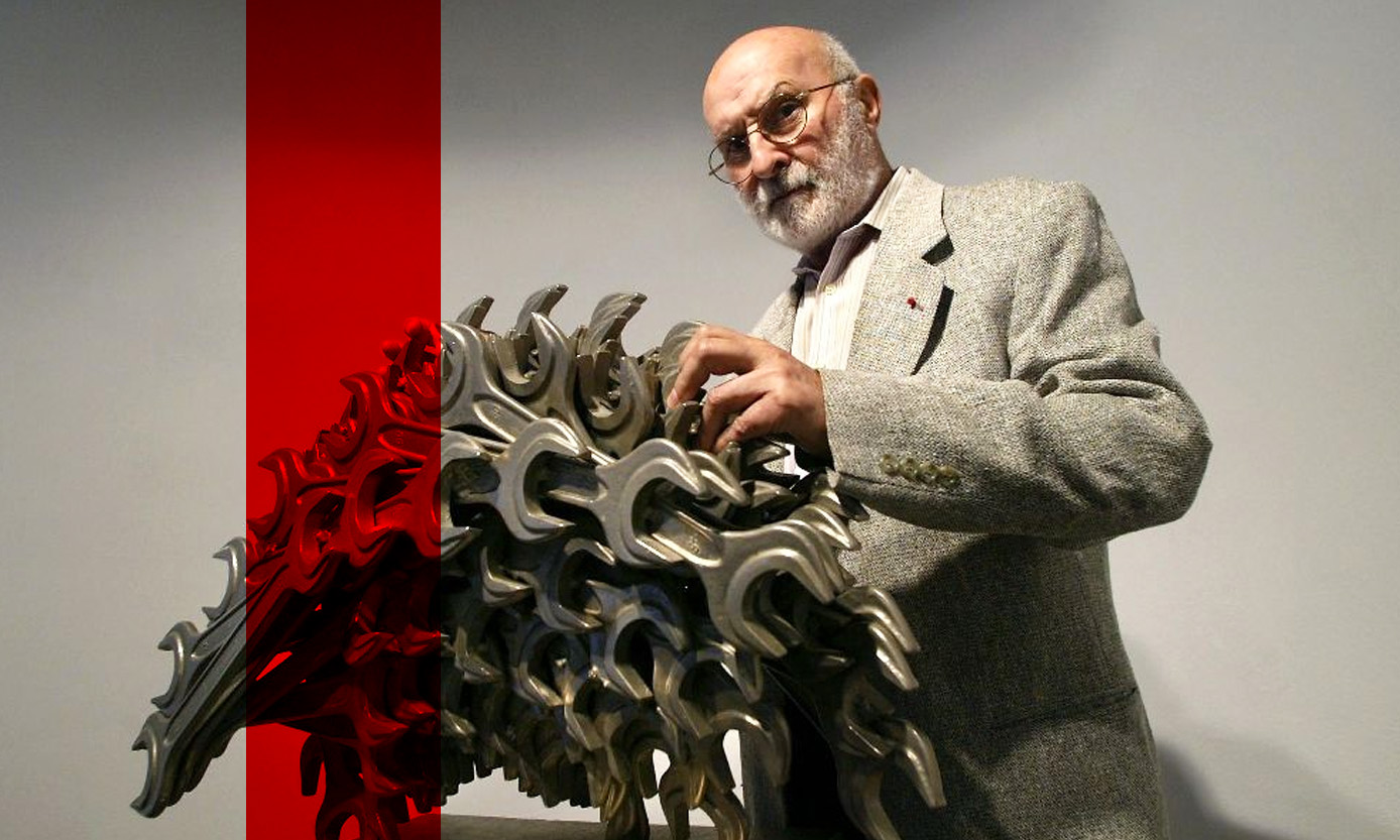 "French-American sculptor Arman -- seen with one of his works, ""Stegosaurus Plieros"""